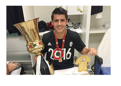 Morata posing for a photo with a trophy wearing a Juventus 2016 winners shirt