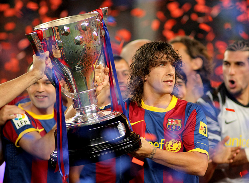 Carles Puyol Lifting the La Liga trophy with Barcelona FC
