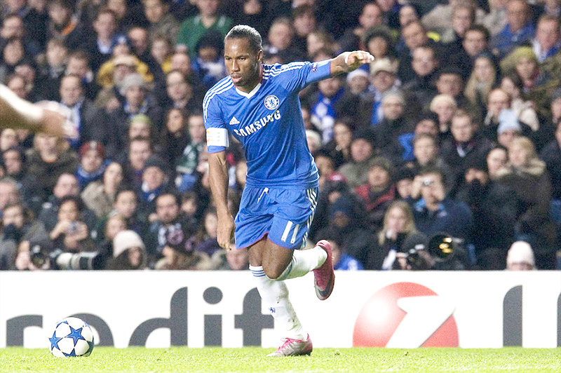 Didier Drogba in Chelsea FC shirt, taking a kick - UEFA Champions League