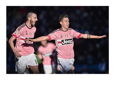 Paolo Dybala and Giorgio Ciellini celebrating a goal in Juve pink away jerseys