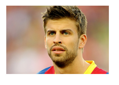 Gerard Pique wearing a Barcelona FC jersey - Year 2011
