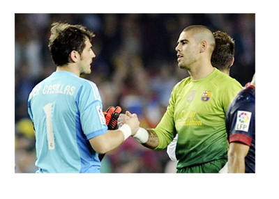 Real Madrid and Barcelona FC legends - Iker Casillas and Victor Valdes - Archive post game photo
