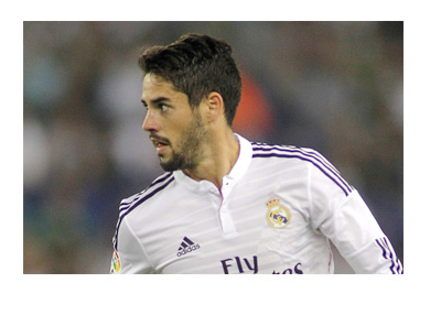 Real Madrid player Isco is looking to pass the ball to one of his teammates