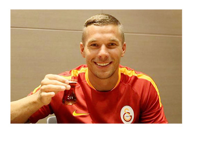 Lukas Podolski is just about to take a sip of Turkish coffee after inking a deal with Galatasaray