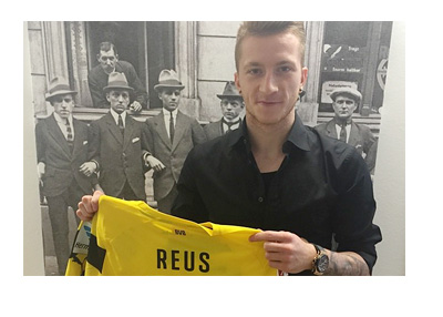 Marco Reus Extends BVB Contract Until 2019 - Holding Jersey in Front of an Old Photo