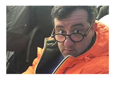 Mino Raiola - Social media profile picture - Red jacket and thick frame glasses