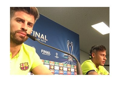 Selfie photo by Barca defender Gerrard Pique at a FIFA press conference.  Neymar is in the background too, answering questions to the press.