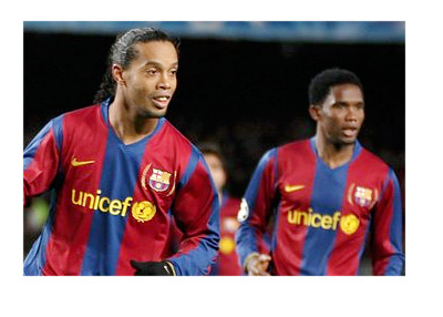 Gaucho Ronaldinho and Samuel Etoo playing for Barcelona FC