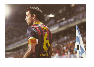 Retro photo of Xavi in a Barcelona home shirt - Number 6 on the back - looking into the distance