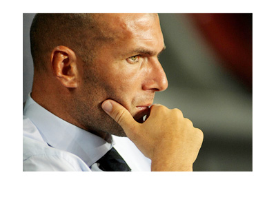 Zinedine Zidane is in deep thought, dressed up in a suit and tie