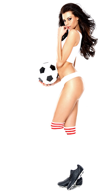 The good looking brunete girl is holding a football and looking at you