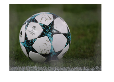 The 2017-18 edition of the UEFA Champions League ball - In action - Covered with grass.