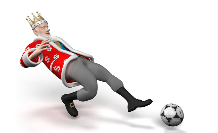 The Football King is stretching to reach the ball with his left foot.  The chances of a goal are high.