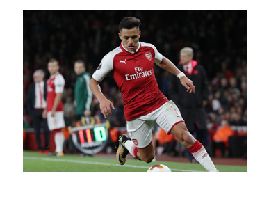 Arsenal FC attacker, Alexis Sanchez, in action - dribbling the ball.  2017-18 season.  Next up: Chelsea FC.