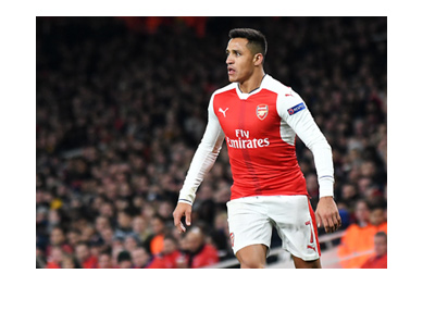 Alexis Sanchez is in action for Arsenal FC.  Trademark pose.
