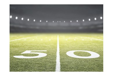 The American football field - 50 yard line - wide angle shot - Game odds.