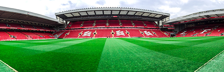 Anfield stadium pre match.  Seats are empty and grass is fine.  Anticipatin is high ahead of the upcoming match vs. Everton.