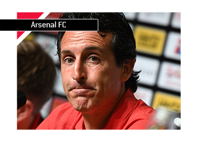 Arsenal FC manager Unai Emery casts a worried figure at a press conference.  It is still early in the season.  Year is 2018.
