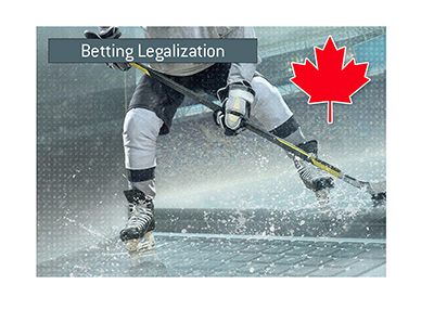 The status of legal betting in Canada.  Hockey player bursting out of a laptop computer.