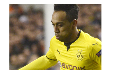 Pierre Emerick Aubameyang of Borussia Dortmund chasing the ball, wearing the traditional yellow.