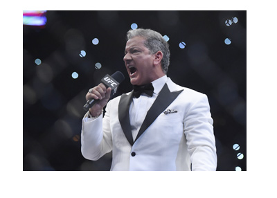 The famous UFC announcer Bruce Buffer, photographed in action moments before the fight starts.