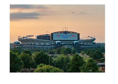 The Carolina Panthers stadium and sunset.  Bank of America.