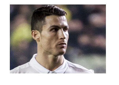 Real Madrid left wing, Cristiano Ronaldo, is looking into the distance.  Match vs. Bayern is coming up.