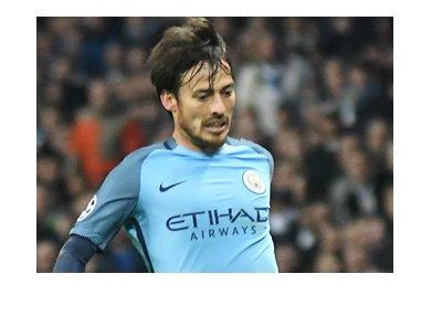 Manchester City FC midfielder - David Silva - In action - Wearing home light blue kit.