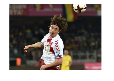 The Denmark midfielder, Thomas Delaney, heading the ball during World Cup qualifiers.  Year is 2017.