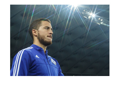 Eden Hazard is walking out onto the pitch.  Under the spotlight.