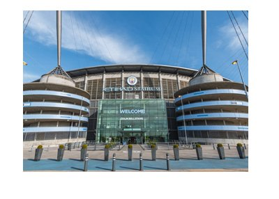 The Etihad Stadium - home of Manchester City Football Club - View from the front.  Sunny day.
