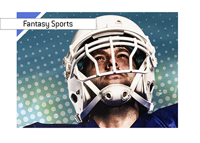 American football player looking up into the sky.  Fantasy sports is alive and well in the United States.