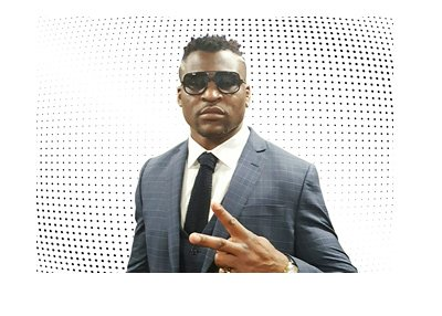 The MMA fighter Francis Ngannou is representing with a peace sign.