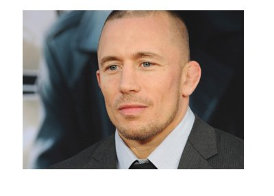 Georges St-Pierre rocking a suit and tie at a movie promotion event.