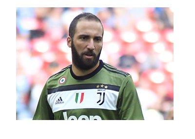 Gonzalo Higuain sporting the Juventus 2017-18 green away kit.