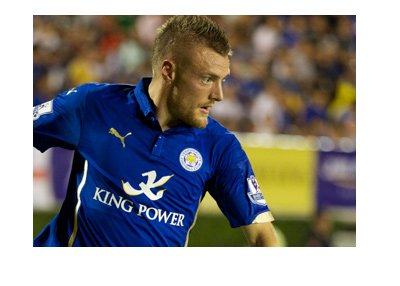Leicester City forward Jamie Vardy.  In action. Dribbling the ball.