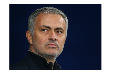 Jose Mourinho is looking into the distance.  Smirking perhaps.