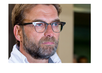 Liverpool FC manager Jurgen Klopp is in the zone.  Gazing into distance.