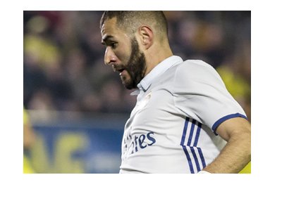 Karim Benzema in action wearing the home Real Madrid 2016/17 jersey.