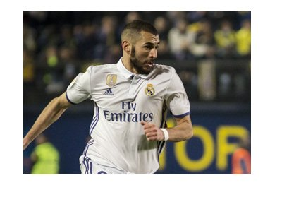 Real Madrid center forward - Karim Benzema - In action, wearing the home white colours.