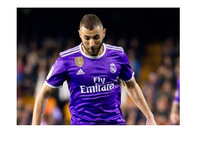 Karim Benzema is sporting the Real Madrid 2017 purple kit.  In action.  Super Cup vs. Barcelona is coming up.