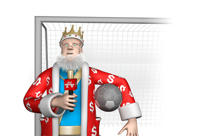 The King is standing in front of goal with a football under one hand and a mic in the other.  The report is in progress.