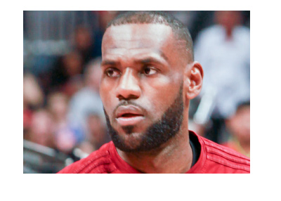 Lebron is sporting a serious look ahead of a basketball match.  Focus, check.