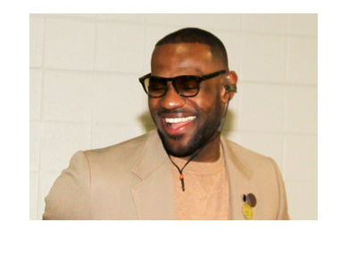 Where is Lebron James going to end up before next season starts?  Pictured wearing a suit and a smile.