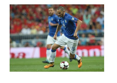 Italian defender, Leonardo Bonucci, dribbling the ball wearing the home blue national side kit.  Year is 2017.