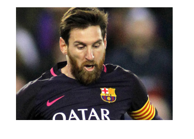 Bearded Lionel Messi in action for Barcelona FC.  Dark kit.  Year is 2017.