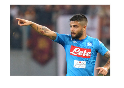 Napoli attacker, Lorenzo Insigne, pointing up, leading his team, hoping for the Scudetto.