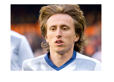 Real Madrid midfielder Luka Modric - Light jog before the game.  Year is 2017.