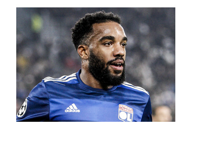 Alexandre Lacazette, the lethal Lyon FC forward, pictured smiling in the photo.  Wearing the home blue.