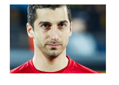 Henrikh Mkhitaryan wearing a Manchester United shirt.  Before the game photoshoot. Year is 2017.